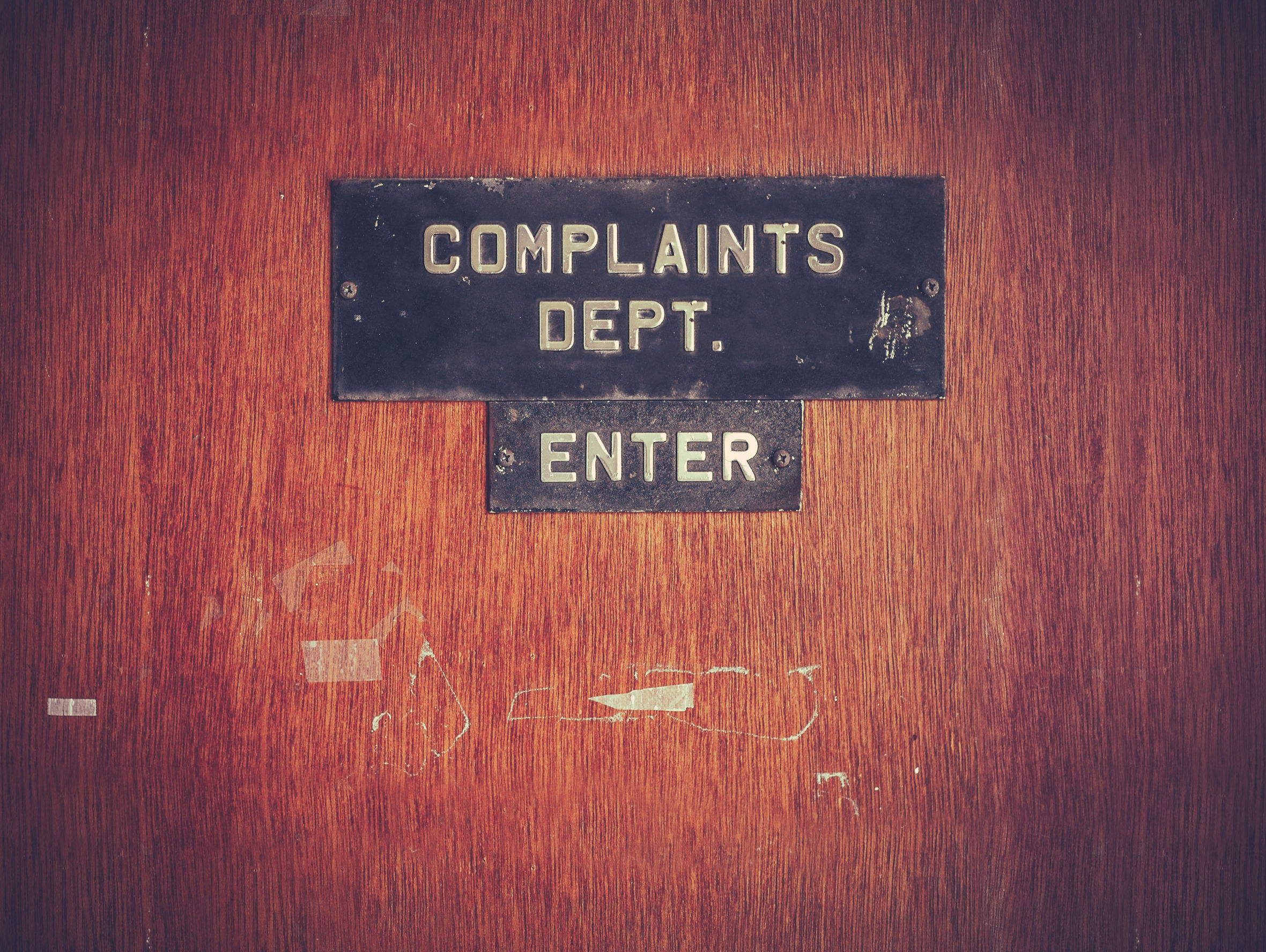 complaints department sign on a door
