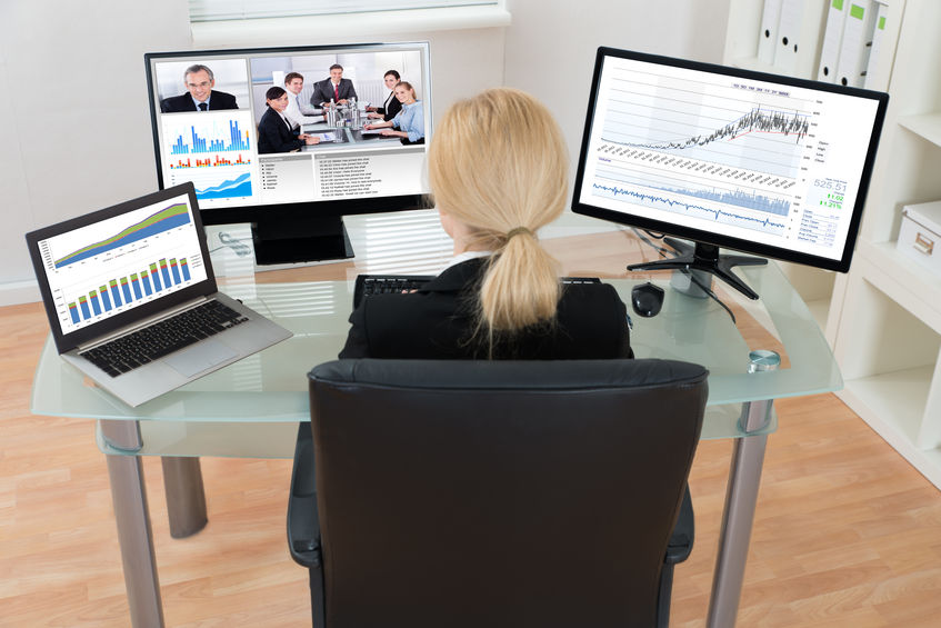 business woman leading a meeting in a video conference